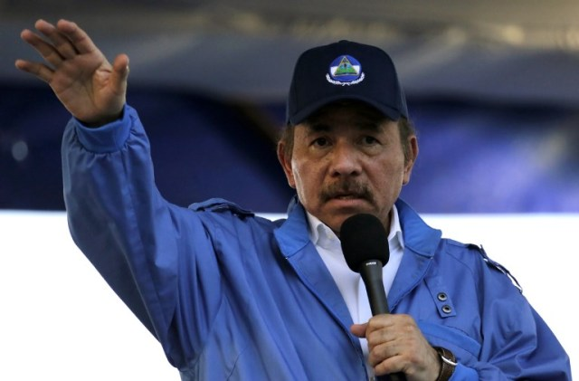 """Nicaraguan President Daniel Ortega speaks during the commemoration of the 51st anniversary of the Pancasan guerrilla campaign in Managua, on August 29, 2018.   Ortega called the UN High Commissioner for Human Rights """"infamous"""" and """"terror instrument"""", after it denounced Wednesday systematic human rights violations in the framework of opposition protests in which 300 people were killed.  / AFP PHOTO / INTI OCON"""